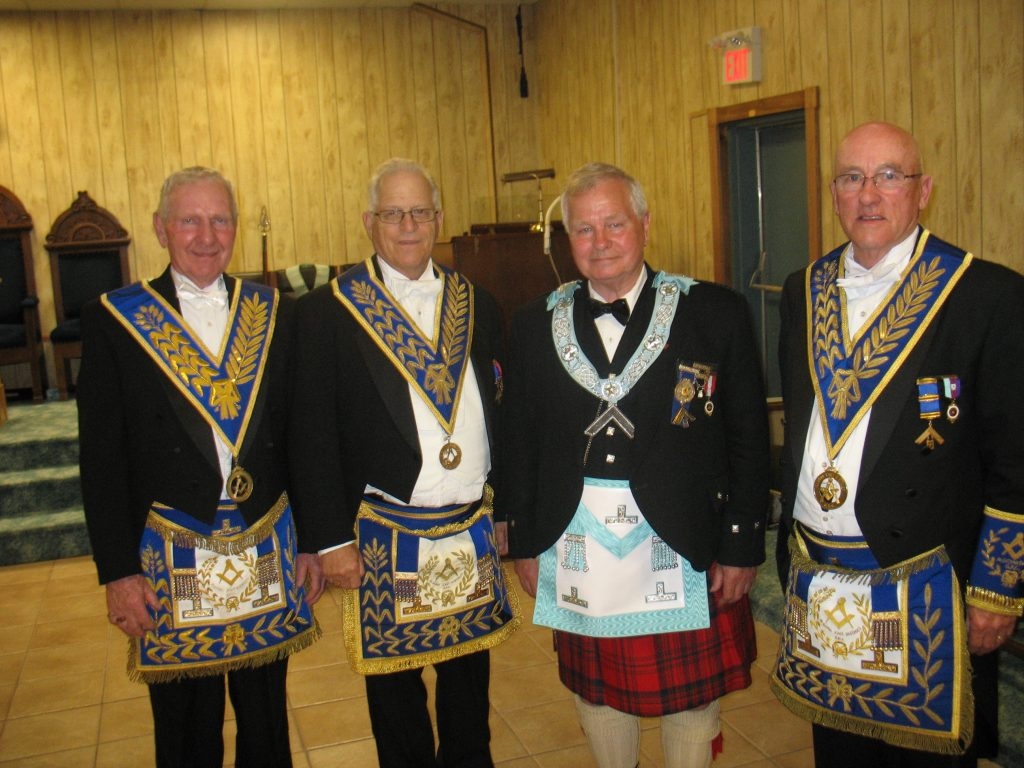 Left to Right: R.W. Bro Ken Pierce, R.W. Bro. Robert McLean, New Worshipful Master of Elliot Lake Lodge No. 698 for 2016 / 2017 R.W. Bro. Norm Mathie and R.W. Bro. Henry Lewis DDGM 2015 /2016